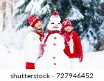 children build snowman. kids... | Shutterstock . vector #727946452
