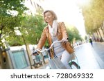 senior woman riding city bike... | Shutterstock . vector #728069332