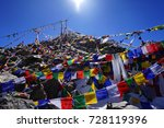 Small photo of Khardung La pass with Tibetan Flag, highest motor-able road on the world, Kashmir, India (blessing sun script)