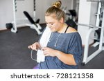 fat girl in a gym | Shutterstock . vector #728121358