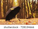 umbrella with an autumn leaf in ... | Shutterstock . vector #728134666