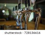 beer taps in row at restaurant | Shutterstock . vector #728136616