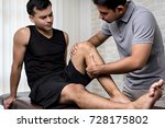 therapist treating injured knee ... | Shutterstock . vector #728175802