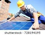 Worker Installing Solar Panels...