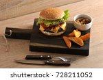 juicy cheeseburger on a wooden...   Shutterstock . vector #728211052