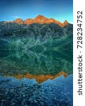 Small photo of Alpenglow Reflection on Morskie Oko