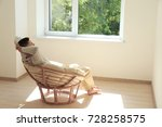 young man resting in armchair... | Shutterstock . vector #728258575