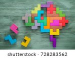 Stock photo human brain is made of multi colored wooden blocks creative medical or business concept 728283562