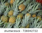 pile pineapple fruit which has... | Shutterstock . vector #728342722