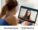 Small photo of Two female friends chatting via video conference application. Woman in headphones talking to long distance friend. Foreign language exchange, virtual communication, international friendship concept.