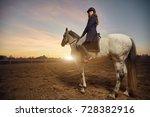 woman riding a horse   Shutterstock . vector #728382916
