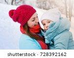 young mother hugs her little... | Shutterstock . vector #728392162