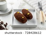 cakes rum ball in a white plate ... | Shutterstock . vector #728428612