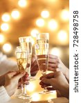 champagne glasses in hands on... | Shutterstock . vector #728498758