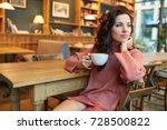 pretty woman drinking coffee in ... | Shutterstock . vector #728500822