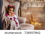 a very excited young girl sits... | Shutterstock . vector #728507842
