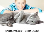 Stock photo cat pampering indoors and defocused smiling woman 72853030