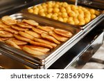 buffet line of lunch and dinner | Shutterstock . vector #728569096