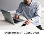 man using a smartphone. close... | Shutterstock . vector #728572906