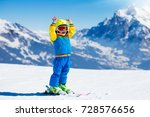 child skiing in mountains.... | Shutterstock . vector #728576656
