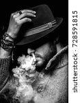 mysterious man in hat vaping | Shutterstock . vector #728591815