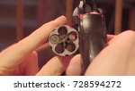 Small photo of Male hand reload a revolver. Magnum gun without bullets , Magnum revolver and empty bullet, Magnum. lead round nose. 45 auto rim revolver rounds.
