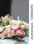 pink roses on a flower market... | Shutterstock . vector #728604292