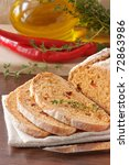 Homemade Mexican bread with paprika and olive oil. - stock photo