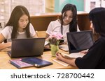 three young asian students are... | Shutterstock . vector #728700442