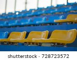 empty yellow and blue seats... | Shutterstock . vector #728723572