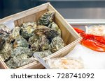 fresh oysters on display at... | Shutterstock . vector #728741092