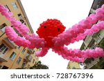 Small photo of An octopus of red balloons hanging over the street decoration during a holiday in Batumi. Adzharia, Batumi, September 2017
