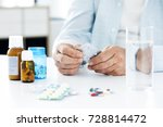 old man taking pills | Shutterstock . vector #728814472