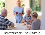 photo of three seniors eating... | Shutterstock . vector #728858935