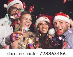 four young people on a new year'... | Shutterstock . vector #728863486