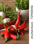 Bunch of red hot chili peppers on a wooden table. - stock photo