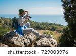 a blond woman tourist with... | Shutterstock . vector #729003976