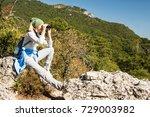 a blond woman tourist looking... | Shutterstock . vector #729003982