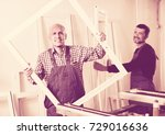 two smiling workmen in coverall ... | Shutterstock . vector #729016636