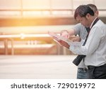 photographer looking map for... | Shutterstock . vector #729019972