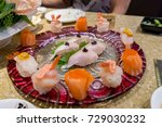 Small photo of Elegant assorted sushi in a high class restaurant: amberjack, salmon, crab roe, shrimp