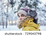 Grey Cat And Young Man In...