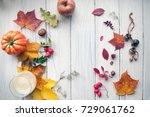 autumn leaves on wooden... | Shutterstock . vector #729061762