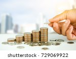 man's hand put money coins to... | Shutterstock . vector #729069922