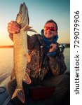 happy angler holds the pike... | Shutterstock . vector #729079906