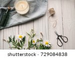 chamomile on the wooden table... | Shutterstock . vector #729084838