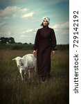 Small photo of Amish styled model is posing with animals