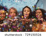 young women blowing confetti... | Shutterstock . vector #729150526