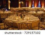 wedding reception table set for ... | Shutterstock . vector #729157102