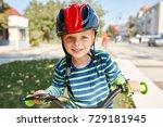boy in helmet standing with...   Shutterstock . vector #729181945